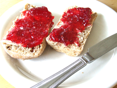 Home made raspberry jam on home made granary rolls.